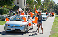 Women's soccer. Homecoming gets kicked off with the traditional car parade through the quad, Thursday, Oct. 23, 2014. (Photo by Marc Campos, College Photographer)