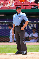 Home plate umpire Jennifer Pawol between innings of a Midwest League game between the Quad Cities River Bandits and the Kane County Cougars on July 1, 2018 at Northwestern Medicine Field in Geneva, Illinois. Quad Cities defeated Kane County 3-2. (Brad Krause/Four Seam Images)