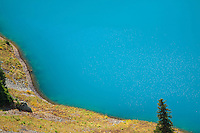I used a polarizer to minimize, but not eliminate, the sunlight reflected in the brilliant blue water of Lower Blue Lake in the Mt. Sneffels Wilderness.<br /> <br /> Canon EOS 5D, 70-200 f/2.8L lens