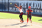 19 February 2017: Louisville's Tiarra Sanabria (4) catches the ball, forcing Ohio State's Emily Clark (20) out at first base. The Ohio State University Buckeyes played the University of Louisville Cardinals at Anderson Family Softball Stadium in Chapel Hill, North Carolina as part of the ACC/Big 10 College Softball Challenge. OSU won the game 4-3.