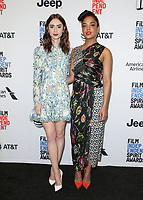 WEST HOLLYWOOD, CA - NOVEMBER 21: Lily Collins and Tessa Thompson at the Film Independent Spirit Awards Press Conference at The Jeremy Hotel in West Hollywood, California on November 21, 2017. Credit: Faye Sadou/MediaPunch