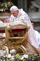 Pope Benedict XVI meets children during the midndight Christmas Mass in Saint Peter's Basilica at the Vatican late 24 December 2009.