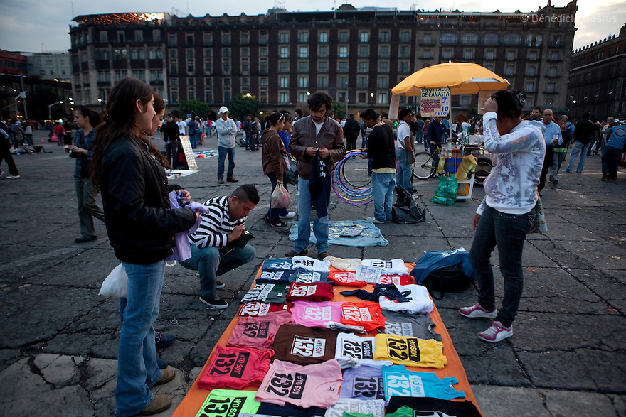 """30 June 2012 - Mexico City, Mexico - Vendors sells tshirt of Yo Soy 132. Thousands of demonstrators and university students members of the movement ?yo soy 132? (I am 132) hold candles during a demonstration to demand transparency in the next election at Zocalo square in Mexico City. """"YoSoy132"""" movement was organized by students against the candidature of Enrique Pena Nieto, presidential candidate of the opposition Institutional Revolutionary Party (PRI), who also demanded a balance in the media coverage of the presidential race. Mexico's presidential elections will take place on July 1. Photo credit: Benedicte Desrus"""