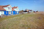 Seaside homes on the beach Shingle Street Suffolk