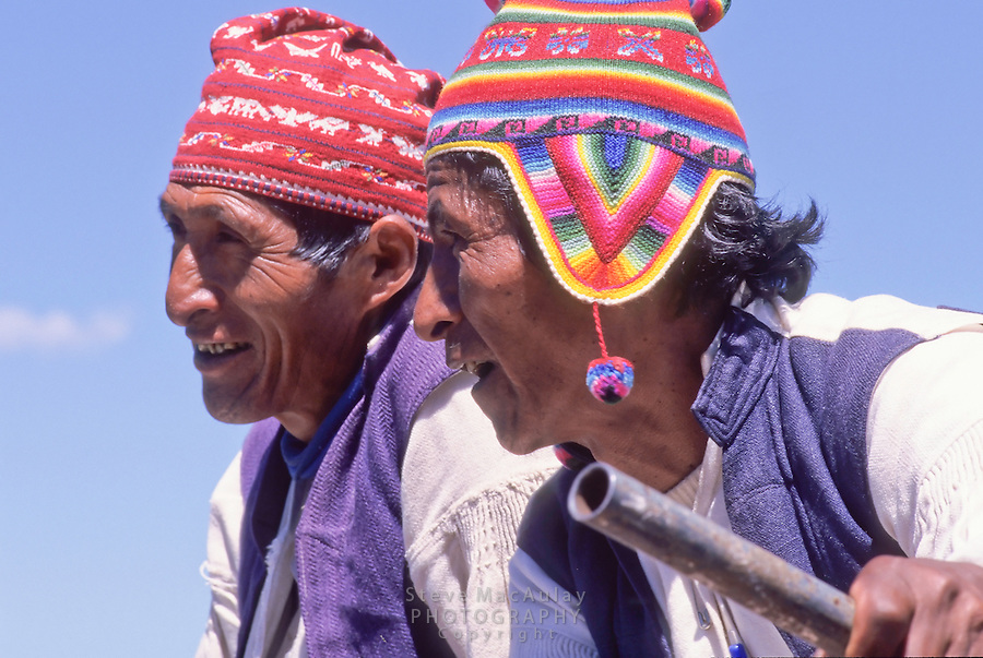 Peruvian men in traditional hat and tunics, Taquile Island, Lake Titicaca, Peru