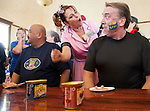 Contestants in the Spam eating contest, Roy Guira, of Oakgrove, and Michael Kennedy, of Antioch, are cheered on by the crowd and Deanna Lambka, of Lodi, at the Isleton Spam Festival at Peter's Steakhouse in Isleton, California, on Sunday, February 16th, 2014.  Photo/Victoria Sheridan