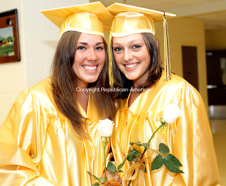 Thomaston, CT- 21, June 2010-062110CM07  Thomaston High School graduates, Jessica Ireland and Sciarra Brandt pose before heading into the auditorium for commencement ceremonies Monday night.     --Christopher Massa Republican-American