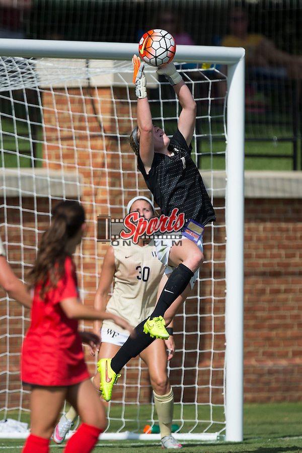 Lindsay Preston (1) of the Wake Forest Demon Deacons makes a save during first half action against the Georgia Bulldogs at Spry Soccer Stadium on August 23, 2015 in Winston-Salem, North Carolina.  The Deacons defeated the Bulldogs 4-0.   (Brian Westerholt/Sports On Film)