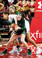 COLLEGE PARK, MD - DECEMBER 8: Shakira Austin #1 of Maryland and Ashley Hunter #15 of Loyola battle for the ball during a game between Loyola University and University of Maryland at Xfinity Center on December 8, 2019 in College Park, Maryland.