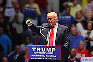 Richmond, VA - June 10, 2016:  Republican presidential candidate and businessman Donald J. Trump points to members of the media before he speaks at a campaign rally at the Richmond Coliseum in Richmond, VA, June 10, 2016. Trump is the presumptive nominee for his party, having won the required number of delegates.  (Photo by Don Baxter/Media Images International)