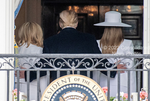 United States President Donald J. Trump, center, walks with first lady Melania Trump, right, and Brigitte Macron, left, into the Blue Room following a photo opportunity after an arrival ceremony for President Emmanuel Macron of France , on the South Lawn of the White House in Washington, DC on Tuesday, April 24, 2018.<br /> Credit: Ron Sachs / CNP