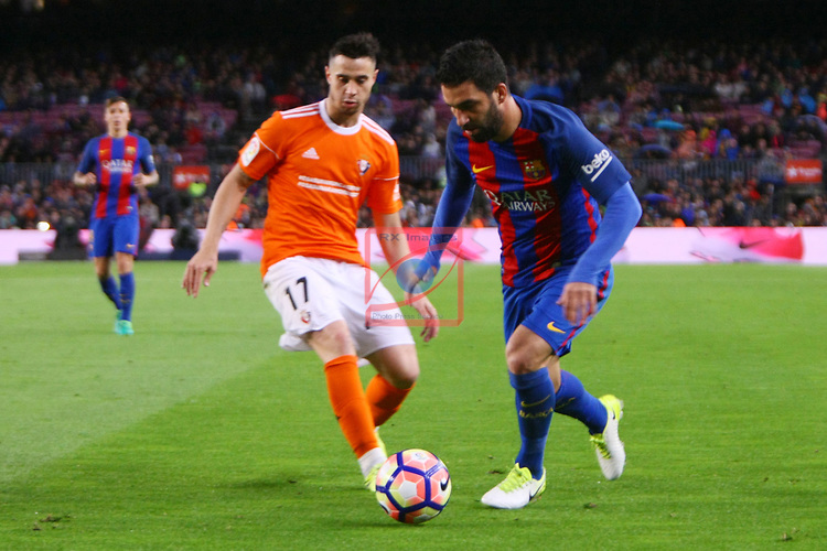 League Santander 2016/2017. Game: 34.<br /> FC Barcelona vs CA Osasuna: 7-1.<br /> Jaime vs Arda Turan.