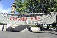 Roma, 12 Maggio 2012.Ponte Garibaldi.In memoria di Giorgiana Masi ,giovane donna uccisa il 12 Maggio 1977 dalla polizia durante un corteo ..Fiori davanti la lapide in sua Memoria