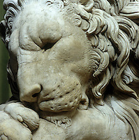 'Sleeping Lion', 1825 by Rinaldo Rinaldini after Canova, is displayed in the Sculpture Gallery at Chatsworth