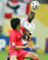 Jae Jin Cho (19) of the Korea Republic battles  William Gallas (5) of France for the ball. The Korea Republic and France played to a 1-1 tie in their FIFA World Cup Group G match at the Zentralstadion, Leipzig, Germany, June 18, 2006.