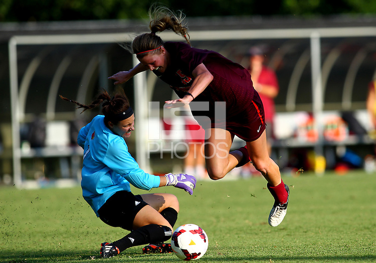WINSTON-SALEM, NORTH CAROLINA - August 30, 2013:<br /> Paige Brown (1) of Louisville University trips Ashley Meier (15) of Virginia Tech during a match at the Wake Forest Invitational tournament at Wake Forest University on August 30. The game ended in a 1-1 tie.