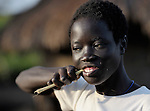 Twelve-year old Charty Moriba, a United Methodist, cleans her teeth in the morning in Pisak, a village in Southern Sudan. NOTE: In July 2011 Southern Sudan became the independent country of South Sudan.