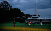 United States President Barack Obama walks back to the residence after he returns to the White House July 14, 2015 in Washington, DC. Obama traveled to Philadelphia to attend a DNC roundtable.<br /> Credit: Olivier Douliery / Pool via CNP