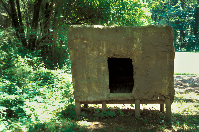 Cache used to store food harvested from traditional gardens on display at the Cherokee National Museum Indian Village, Tahlequay, OK.
