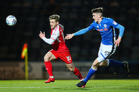 Conor McAleny of Fleetwood Town gets away from Ryan Delaney of Rochdale during the Sky Bet League 1 match between Rochdale and Fleetwood Town at Spotland Stadium, Rochdale, England on 20 March 2018. Photo by Thomas Gadd.