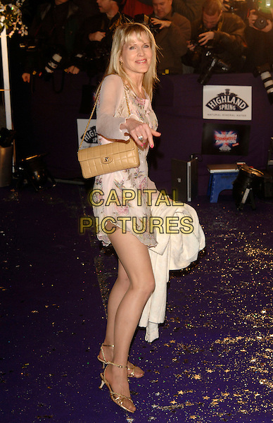GUEST.British Comedy Awards 2006, London Television Studios, London, UK. - Arrivals.December 13th, 2006.full length pink floral print dress beige bag purse hand.CAP/PL.©Phil Loftus/Capital Pictures