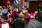 People eating dumplings outside of Nanxiang Mantou Dian restaurant at The Old City of Shanghai, China 2014