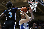 04 November 2014: Duke's Marshall Plumlee (40) is fouled by Livingstone's Shawn Jackson (3). The Duke University Blue Devils hosted the Livingstone College Blue Bears at Cameron Indoor Stadium in Durham, North Carolina in an NCAA Men's Basketball exhibition game.
