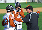 Jersey Shore players try to keep their hands warm during a conference with the coach in the second inning.