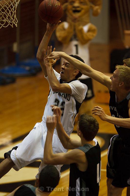 Trent Nelson  |  The Salt Lake Tribune.Highland's Liam Thomas flies to the basket for a layup at Highland vs. Riverton High School basketball in Salt Lake City, Utah, Friday, December 2, 2011.