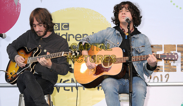 The View.BBC Children In Need's Pudsey Street -photocall, New Piazza, Covent Garden, London, England..3rd November 2012.on stage in concert live gig performance performing music half length black blue jean denim sitting beard facial hair jacket   singing guitar .CAP/PP/BK.©Bob Kent/PP/Capital Pictures