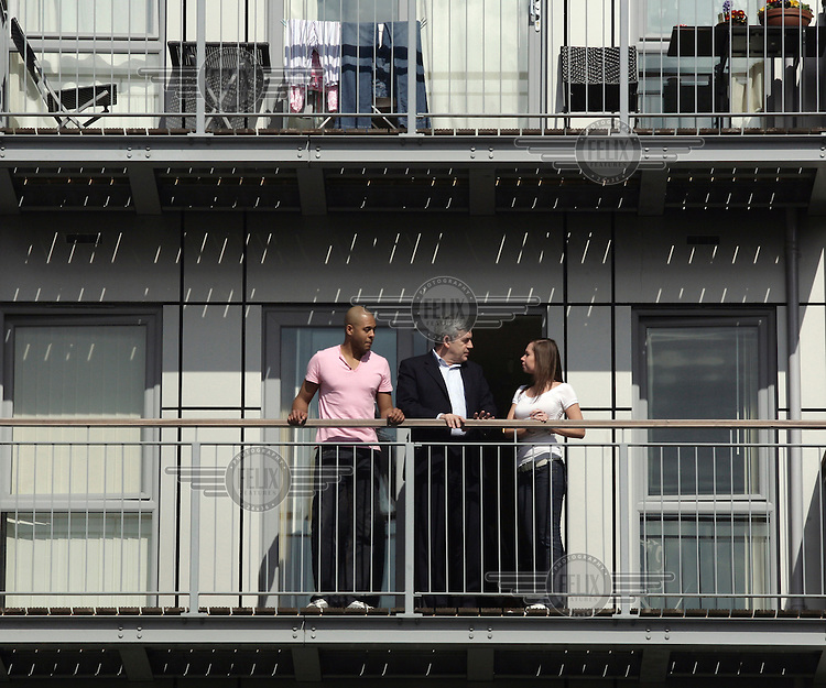 Prime Minister Gordon Brown meets members of the public on the campaign trail before the 2010 general election. He is pictured with Richard Belle and Cheryl Revill on the balcony of the flat the couple bought in Edgware, London with the help of the government under the homebuy direct scheme.