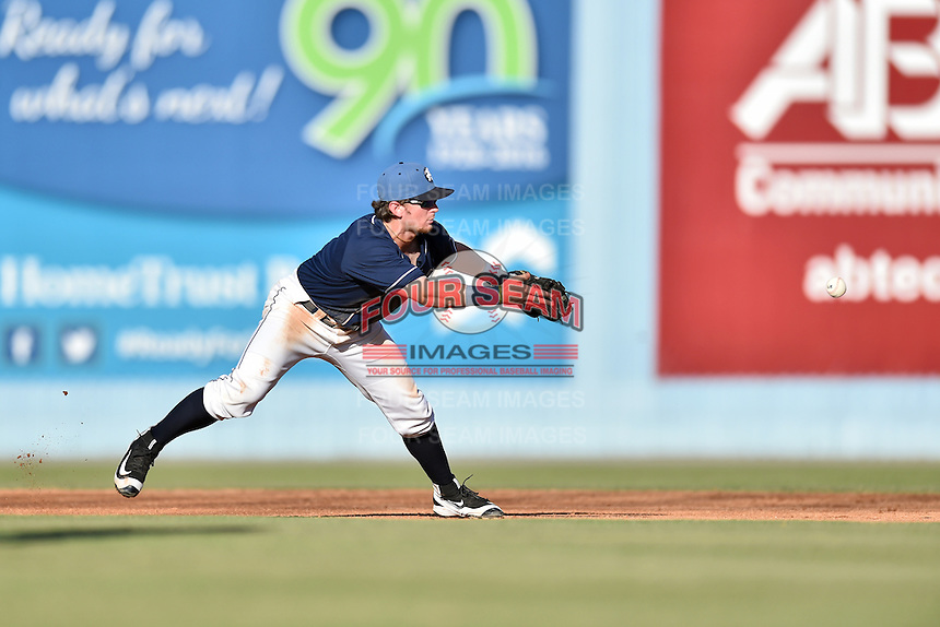 Asheville Tourists shortstop Brendan Rodgers (1) starts the turn on a double play during a game against the Charleston RiverDogs at McCormick Field on July 9, 2016 in Asheville, North Carolina. The RiverDogs defeated the Tourists 10-9. (Tony Farlow/Four Seam Images)