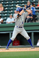 Third baseman Mike Hill (11) of the Lexington Legends bats in a game against the Greenville Drive on Tuesday, April 14, 2015, at Fluor Field at the West End in Greenville, South Carolina. Lexington won, 5-3. (Tom Priddy/Four Seam Images)