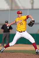 Wyatt Strahan (33) of the USC Trojans pitches against the Jacksonville Dolphins at Dedeaux Field on February 19, 2012 in Los Angeles,California. USC defeated Jacksonville 4-3.(Larry Goren/Four Seam Images)