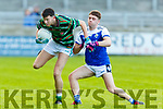 Paul McMahon of St Brendans in possession as danny Power of Shannon Rangers tackles hime, in the County Football Championship 3rd round game on Saturday.