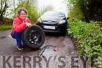 Julie Grey from Gurrane, Firies who is disgusted with the damage done to her wheel due to a 7 inch deep pothole on the Farmer's Bridge road.
