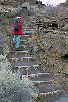 Steps in lava flow in park with photographer. Tule Lake National Wildlife Refuge, California