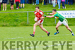 Shane Ryan Rathmore is tracked by Mark Griffin South Kerry during their County Championship clash in Killorglin on Saturday