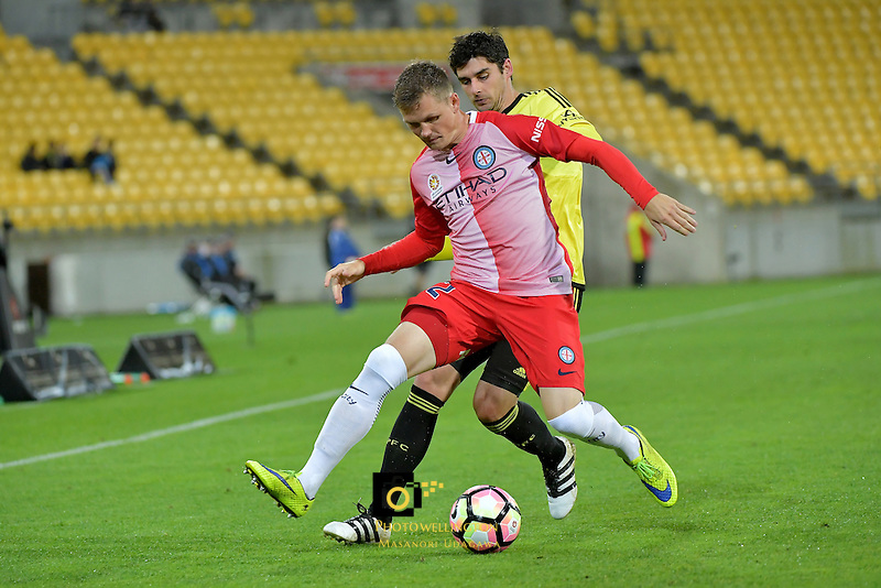 Wellington Phoenix&rsquo;  Guilherme Finkler and Melbourne City FC's Michael Jakobsen in action during the A League - Wellington Phoenix v Melbourne City FC at Westpac Stadium, Wellington, New Zealand on Saturday 8 October 2016.<br /> Photo by Masanori Udagawa. <br /> www.photowellington.photoshelter.com.