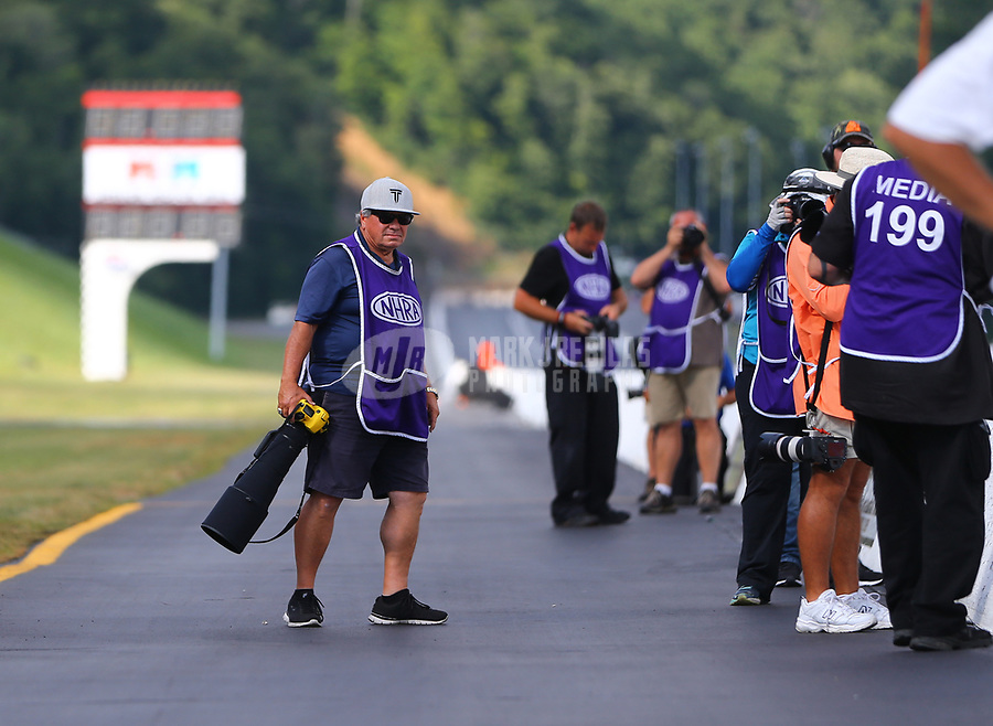 Jun 16, 2017; Bristol, TN, USA; NHRA photographer Richard Shute during qualifying for the Thunder Valley Nationals at Bristol Dragway. Mandatory Credit: Mark J. Rebilas-USA TODAY Sports