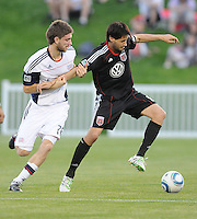 DC United midfielder Branko Boskovic (8) shield the ball against New England Revolution midfielder Stephen McCarthy (26)   The New England Revolution defeated DC United 3-2 in US Open Cup match , at the Maryland SoccerPlex, Tuesday  April 26, 2011.
