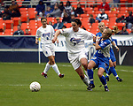 Skylar Little (23) holds on to Birgit Prinz (9) at RFK Stadium in Washington, DC on 5/17/03 during a game between the Carolina Courage and Washington Freedom. Carolina won the game 5-2.