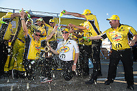 Oct 16, 2016; Ennis, TX, USA; NHRA funny car driver Matt Hagan celebrates with crew after winning the Fall Nationals at Texas Motorplex. Mandatory Credit: Mark J. Rebilas-USA TODAY Sports