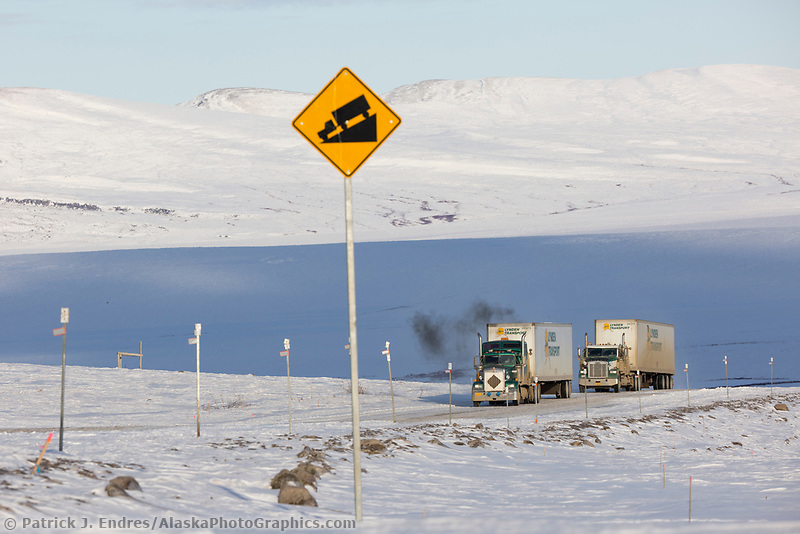 Trucks travel along the James Dalton Highway near Slope mountain in Arctic, Alaska.