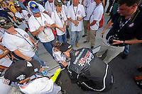 Driver Kurt Busch greets a group of the grid.