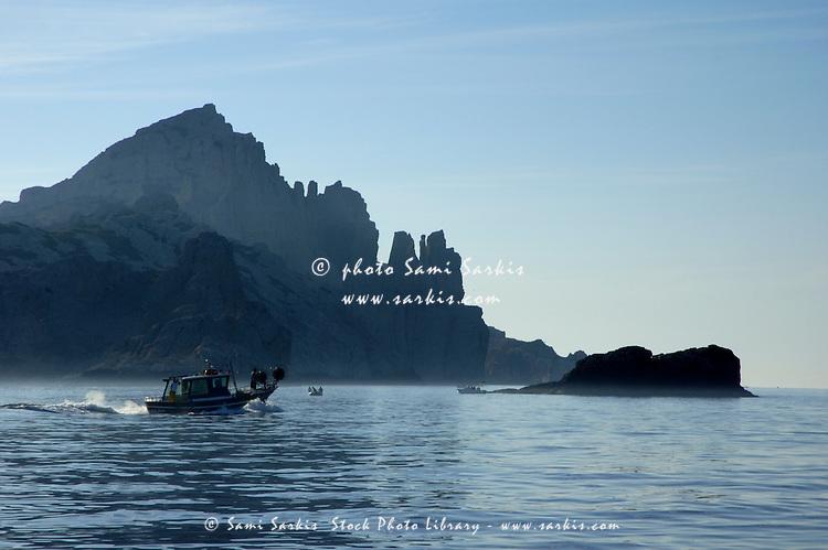 Fishing boat sailing past Riou Island, Marseille, France.
