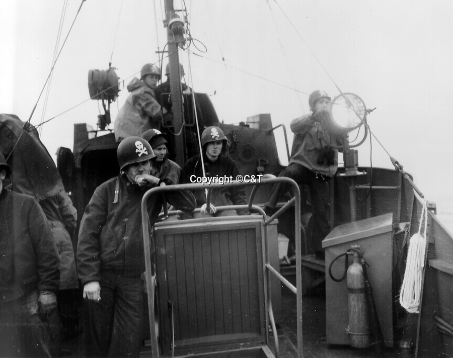 BNPS.co.uk (01202 558833)<br /> Pic: C&T/BNPS<br /> <br /> USCG-6 operating off Omaha beach.<br /> <br /> A historic Jolly Roger flag hoisted above a D-Day ship during the Normandy invasion has surfaced 72 years later.<br /> <br /> The large black flag with a skull and crossbones emblazoned across it was the unofficial insignia for the crew of a coastguard ship that operated off 'bloody' Omaha Beach on June 6, 1944.<br /> <br /> Their job was to rescue soldiers who had had to bale out into the sea from their landing craft during the invasion.<br /> <br /> The 42ins by 47ins flag has now emerged for sale at auction for £1,500.
