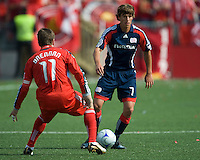 23 May 09: New England Revolution midfielder Wells Thompson #7 and Toronto FC midfielder Jim Brennan #11 in action during a game between the New England Revolution and Toronto FC.Toronto FC won 3-1.