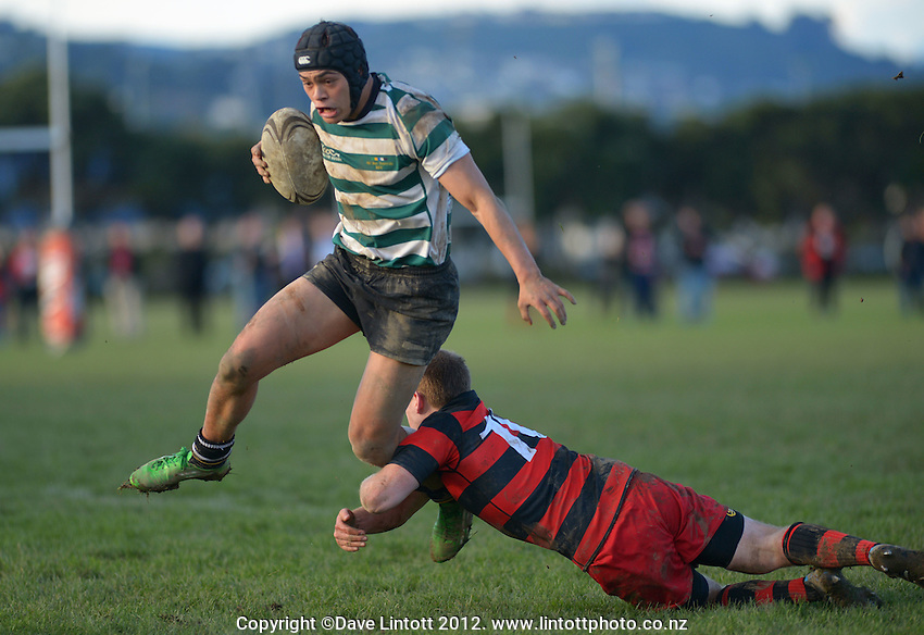 Poneke's Mike Cody tackles Te Wehi Wright during the Wellington Club Rugby Hardham Cup final between Poneke and Old Boys-University at Petone Recreation Ground, Petone, Wellington, New Zealand on Saturday, 11 August 2012. Photo: Dave Lintott / lintottphoto.co.nz