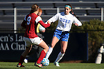 24 November 2013: Duke's Laura Weinberg (16) and Arkansas' Blake Pruitt (9). The University of Arkansas Razorbacks played the Duke University Blue Devils at Koskinen Stadium in Durham, NC in a 2013 NCAA Division I Women's Soccer Tournament Third Round match. Duke advanced by winning the penalty kick shootout 5-3 after the game ended in a 2-2 tie after overtime.